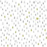 Små hjärtor som är borttappade i regnet på vit Arkivfoto