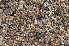 Små kiselstenar vaggar bakgrund Arkivfoto
