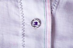 Små knappar för Closeup på den vita torkduken Royaltyfri Fotografi