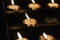 Små kyrkastearinljus Royaltyfria Bilder