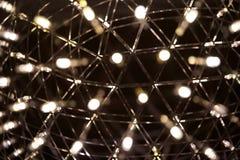 Små ljus av en lampa med bokeh Arkivfoto