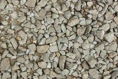 Små stenar på en jordning med sand för bakgrund, design Royaltyfri Bild