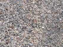 Små stenar på jordningen royaltyfria foton