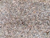 Små stenar på jordningen arkivbilder