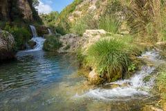 Små vattenfall på Gorgo de la Escalera royaltyfri bild