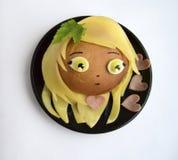 Smörgås i form av huvudet av flickan Arkivbilder