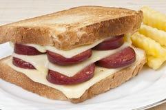 Smörgås med nära övre för korv och för ost Arkivbilder