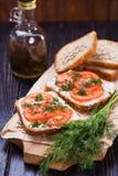 Smörgås med tomater Arkivfoto