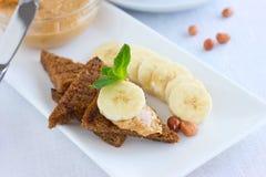 Smörgåsar för jordnötsmör med bananen Fotografering för Bildbyråer