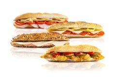 Smörgåsar på vit bakgrund Arkivfoton