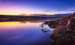 SM jind pink still rise. Gentle sunrise over Jindabyne lake still waters of Snowy Mountains national park in NSW, Australia Royalty Free Stock Photography
