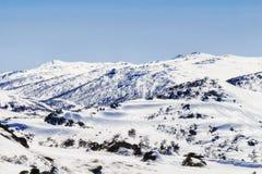 Sm-monteringsmaxima snöar tele Arkivbilder