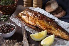 Smażąca ryba z cytryną i pieprzem Obrazy Royalty Free