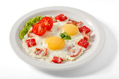 Smażący jajka z bekonem i pomidorami Obraz Stock