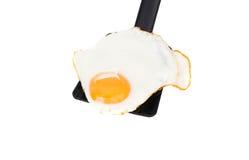 Smażący jajko odizolowywający Zdjęcia Royalty Free