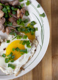 Smażący jajko z mięsem Zdjęcia Royalty Free