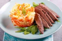 Smażący ryż z marchewką słuzyć i wątróbka Zdjęcia Stock