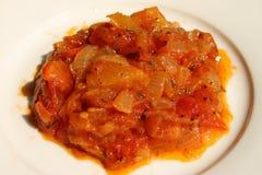 Smażyć cebule i pomidor Zdjęcia Royalty Free
