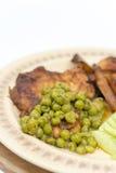 Smażyć stków zielonych grochów posiłek gotować grule Fotografia Stock