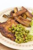 Smażyć stków zielonych grochów posiłek gotować grule Zdjęcie Royalty Free