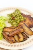 Smażyć stków zielonych grochów posiłek gotować grule Obrazy Royalty Free