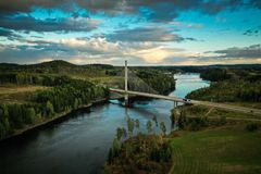 Smaalenene bridge in Norway over river Glomma. At sunset. Glomma is the largest river royalty free stock images