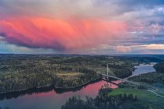 Smaalenene bridge in Norway over river Glomma. At sunset. Glomma is the largest river stock image