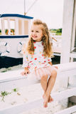Smailing   little girl enjoying sailing on a luxury yacht Royalty Free Stock Photo