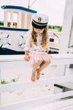 Smailing little girl enjoying sailing on a luxury yacht stock photo