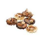 Smakelijke chocoladesnoepjes met noten Royalty-vrije Stock Foto's