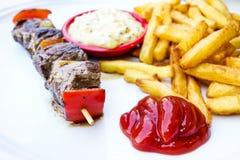 Smakelijke geroosterde vlees en groentenvleespennen stock afbeeldingen