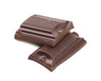 Smakelijke hap van donkere chocolade. stock foto's