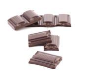 Smakelijke hap van donkere chocolade. royalty-vrije stock afbeeldingen