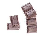 Smakelijke hap van donkere chocolade. stock afbeeldingen
