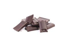 Smakelijke hap van donkere chocolade. stock fotografie