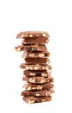 Smakelijke hap van melkchocola met noten. stock foto's