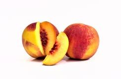 Smakelijke perziken, twee nectarines Stock Afbeelding