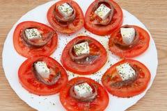 Smakelijke tomatenplakken met kaas Stock Fotografie