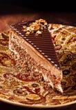 Smaklig chokladkaka med muttrar Arkivfoto