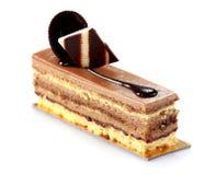 Smaklig chokladkaka med toppning Royaltyfria Foton