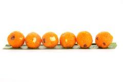 Smaklig indisk orange ladoo arkivfoto