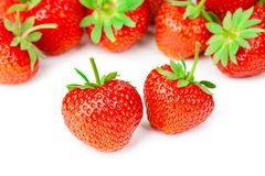 Smakliga jordgubbar som isoleras på vit bakgrund Arkivbild