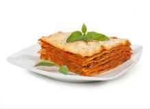 Smakliga lasagner på plattan Royaltyfri Fotografi