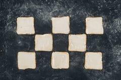 Smakliga rostade bröd med smör Royaltyfria Bilder