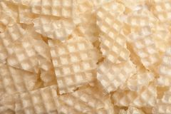 Smakowici zdruzgotani opłatki jako tło Crispy jedzenie obraz stock