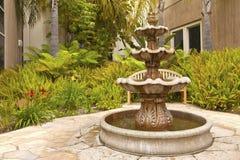 Smal backyard garden fountain San Diego California. Stock Photos