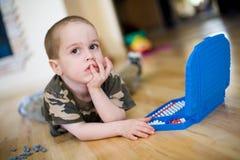 Smal boy is thinking Stock Photos