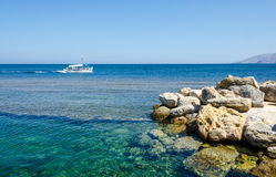 Smal fishing boat floating on turquoise calm waters of Skiros island, Greece. Royalty Free Stock Image