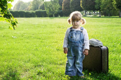 Smal girl with suitcase Royalty Free Stock Photos