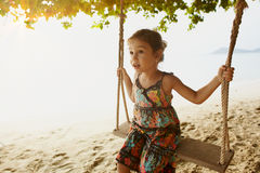 Smal girl swinging on sea coast Royalty Free Stock Photography
